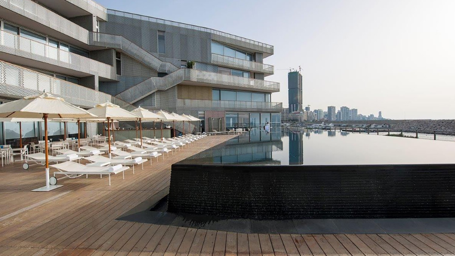 https://stevenholl.sfo2.digitaloceanspaces.com/uploads/projects/project-images/LeYachtClub_Beirut_Pooldeck_7_WH.jpg